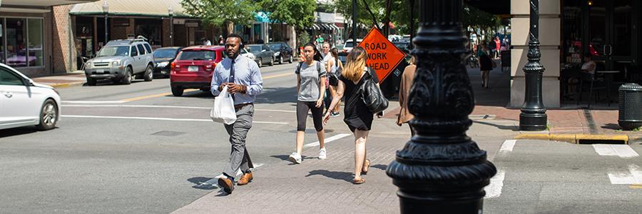 Pedestrians Crossing Bull St. In Savannah Georgia